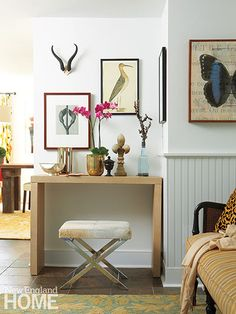 A modern table and bench in the front hall represent contemporary country style.