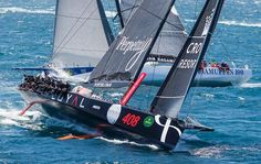 Rolex Sydney Hobart 2014: Perpetual Loyal forced to retire with hull damage seen here earlier  leading Ragamuffin 100 (AUS) as the 100ft Maxi battle begins - 2014 Rolex Sydney Hobart Yacht Race.'    © Rolex / Carlo Borlenghi