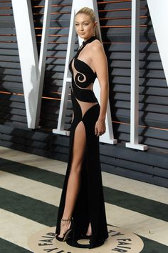 Gigi Hadid wears Atelier Versace gown in black with cutout details, Vanity Fair Party OScars 2015 Gigi Hadid Looks, Versace Gown, Best Street Style, Oscar Fashion, Vanity Fair Oscar Party, Celebrity Look, Costume, Beautiful Gowns, Sexy Dresses