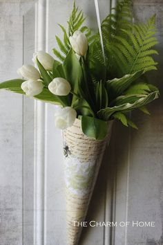 May Day basket filled with white tulips & greenery