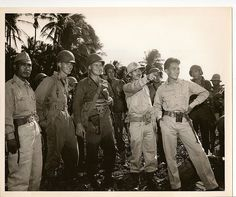 Filipino Officer & American Troops On Panay.  Seizing another strategic island in the Philippine campaign - and in a sense avenging the Japanese sinking of the gunboat USS Panay in China on December 10th, 1937 - US forces smash ashore on the island of Panay in the Philippines on March 18th 1945. Within 60 hours - thanks to the effective preparatory activities of the Philippine fighters - all Japanese resistance was crushed.