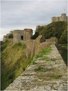 """Dover Castle is a medieval castle in Dover, Kent.   It was founded in the 12th century and has been described as the """"Key to England"""" due to its defensive significance throughout history. It is the largest castle in England."""