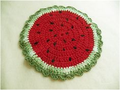 Watermelon in-the-round. These instructions turn this into a potholder/trivet, but I think it would be fun to make a version for summer place mats or small ones as coasters for drippy summer drinks.