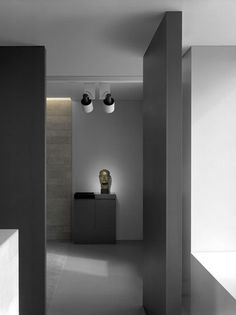 Sleek interior in neutral tones and lighting design on the sculpture  _
