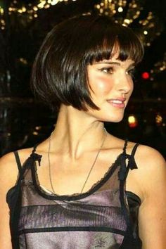Gorgeous bob with bangs; deep brunette