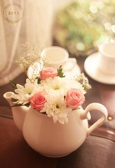 Perfect. I love the clean, white teapot with the white flowers and pops of green and pink.