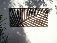 Urban Design Systems Laser cut wall leaf. Weathering Steel
