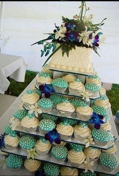 Buy sams club cupcakes and cake, arrange yourself. Do any theme. Peacock Wedding Cake and Cupcakes. Cupcake Stand Wedding, Wedding Cakes With Cupcakes, Cupcake Cakes, Cupcake Stands, Cupcake Tier, Sams Club Cupcakes, Elegant Cupcakes, Decorated Cupcakes, Blue Cupcakes