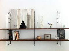Floating shelves that I actually like; perhaps worth the holes in the wall.