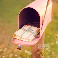 How cute would this be..to have a pink mailbox with letters addressed to you?
