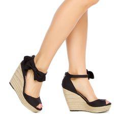 Pretty side bow wedge sandal.