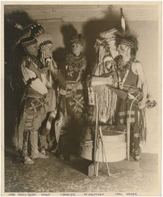 Title:John Young Bear, Spohr, Milford Chandler, Dr. Charles A. Eastman, Carl SpohrDescription:Indoor portrait of group posed in traditional clothing. From L: John Young Bear, Spohr, Milford Chandler, Dr. Charles A. Eastman, Carl Spohr. Photographed at the Birth of Chicago Pageant in 1933?Culture/People:Sac and Fox (Sauk & Fox), Wahpetonwan Dakota (Wahpeton Sioux), and Non-IndianDate created:circa 1933Photographer:Ravenswood Photo ShopPlace:Chicago; Cook County; Illinois; USA…