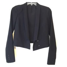 Urban Outfitters shrunken blazer Sparkle & Fade for Urban Outfitters long sleeved, hip-cut tuxedo jacket with shawl lapels and asymmetrical button stance. This classic shrunken blazer comes with button details on the wrist and front as well as slit pockets at the waist. Interior button closure. Fully lined (shell: 65% polyester, 35% rayon; lining: 100% polyester). Professional and stylish! Worn a few times. Small hole on the seam of armpit, would be an easy fix. Otherwise in excellent…