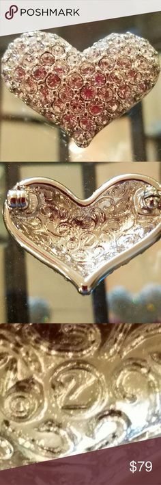 Swarovski Signed Heart Rhinestone Vintage Pin This circa 80s rhinestone heart pin is in excellent condition with all stones in tact. It is NWOTs. Crystal clear stones are set in silver tone setting. Clasp is in good condition. The Swarovski Swan hallmark is stamped on the back. The pin is 1.5 inches wide by 1 inch tall. This pin is great for any occasion from romantic all the way to professional.  This is classic Swarovski! Swarovski Jewelry Brooches