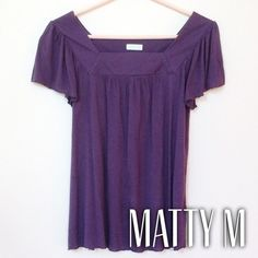 "Matty M plum colored blouse Purple short sleeve shirt with square cut collar and flutter sleeves. A gorgeous plum color. Brand is Matty M, purchased at Nordstrom. Made in USA. 100% modal. Hand wash. Size small. Measures 16.25"" in bust and waist, 23.25"" shoulder to hem. Has some loose threads at sleeves and hem. Collar on back also has the smallest tear. See pictures. A wonderful basic or top for work. Reasonable offers accepted! Matty m Tops Blouses"
