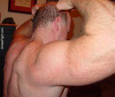 grandad flexing his massive arms biceps