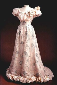 Pink chiffon evening dress worn by Tsaritsa Alexandra Feodorovna  This ball dress has a train that was presumably caught up and carried by the Empress and puffed, maybe leg-o-mutton, sleeves.