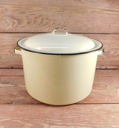 Vintage Yellow Enamel Stock Pot  Measures 8 1/2 inches in height to the top of the lid handle, and 1