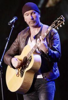 The Edge on his Gibson J-200
