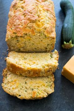 This savory Cheddar Zucchini Bread is perfectly soft and buttery and packed with flavor! This savory Cheddar Zucchini Bread is perfectly soft and buttery and packed with flavor! Savory Zucchini Bread, Zucchini Cheese, Garlic Cheese Bread, Zuchinni Recipes Bread, Courgette Bread, Breaded Zucchini, Gluten Free Zucchini Bread, Recipe Zucchini, Healthy Recipes