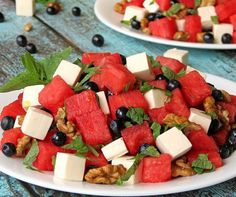 This Strawberry Walnut Salad features spinach, blue cheese, cranberries, and is topped with a fantastic poppy seed dressing. Perfect summer salad!
