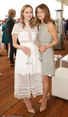 Sister act:  Kara and Hannah Tointon looked ladylike in pretty dresses at the star-studded Audi Polo event