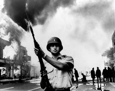 A National Guardsman stands at the ready at a Detroit intersection during the summer riots of 1967. Frustration and despair erupted from the sidewalks of northern U.S. cities where blacks saw little change following the Voting Rights Act of 1965.