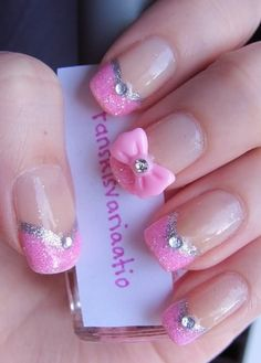 If it's pink & sparkley ...WE WANT IT! :) Pretty pink nail design with glitter, rhinestones, and a cute pink bow.