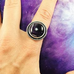 These magical dark purple amethyst ring is gorgeous! Amethyst stone size is approximately 16 mm, overall ring size is about 20 mm. Ring band is adjustable to ac