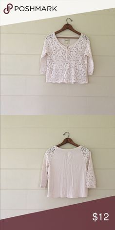 Hollister Lace 3/4 Sleeve Blouse Hollister brand size small cream 3/4 sleeve blouse front fabric is lace like and is see through you'd have to wear a tank top underneath there are 5 buttons going down the front. Bust is 34 inches length is 19 inches. Back: 60% cotton 40% modal lace: 76% cotton 24% nylon. In excellent condition. Tops Blouses