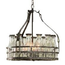 """Got Milk? Milk Bottle Chandelier features 12 glass milk bottles—each embossed with the words """"Fresh Milk"""" and capped with a metal top—in a circular galvanized-metal frame."""