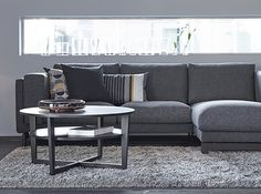 A grey living room with NOCKEBY two seat sofa