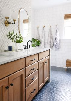 Modern Farmhouse Bathroom Renovation: Gorgeous wooden vanity with carrara marble countertop and mid century style knobs and pulls from Schoolhouse electric. This bathroom also features a blue herringbone tile floor and marble mosaic tile backsplash. Bad Inspiration, Bathroom Inspiration, Bathroom Inspo, Ideas Baños, Decor Ideas, Decorating Ideas, Decor Diy, Rustic Decor, Wall Decor
