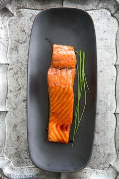 Salmon fillets, glazed with sake and ginger, and either baked, fried, or grilled. Simple, easy, healthy, and delicious. On SimplyRecipes.com