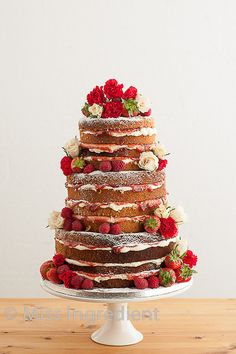 Uniced naked wedding cake by Miss Ingredient. Tiered and stacked with pretty seasonal flowers and delicious fresh fruit. Photo by BH13 Photography. #weddingcake #nakedcake
