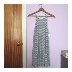 Super soft ribbed dress Super soft and flowy black and white striped ribbed dress. So versatile and perfect to just throw on in the summer on those lazy days.  ❥ BNWT. ❥ Size medium. ❥ Fully lined. ❥ Made in the USA. ❥ 58% rayon, 37% polyester, 5% spandex. Dresses