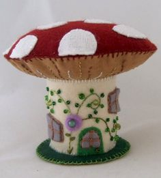 One author shares her passion for felt crafting which is packed with tons of original photos. Image shows: A Beaded and Embroidered Felt Mushroom House.
