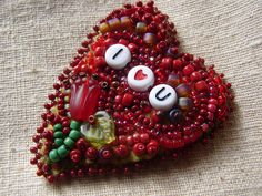bead embroidered heart brooch on felt by Pennsylvania Wilds Artisan Trails, via Flickr