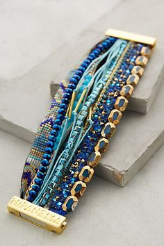 A great use for those partial strands of leftover beads.   Etesian Layered Bracelet - anthropologie.com