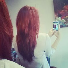 Long red hair with textured layers. Lots of movement!