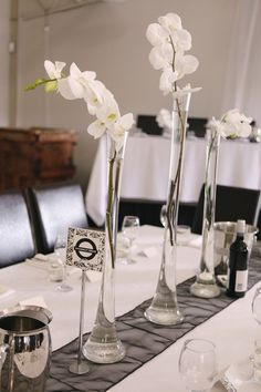 tall clear flute vases white orchid centerpiece   ...........click here to find out more     http://googydog.com              ...... P.S. PLEASE FOLLOW ME IN HERE @Emily Schoenfeld Schoenfeld Wilson