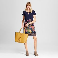 With a straightforward and comfortable cut the Women's Printed Crepe Shift Dress by Merona™ feels fantastic. It's the print that makes the women's placement print floral dress irresistible.
