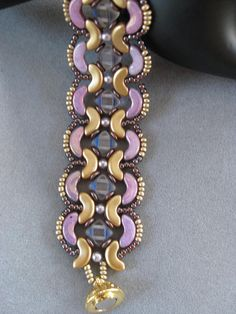 This is a really pretty bracelet pattern with Arcos, Silky beads, Pearls and seed beads. It has a gold magnetic clasp which makes it easy to put on and it is very pretty. The silky beads are Crystal and Burgundy and the arcos are pink and gold. The pattern is Svetlana Chernitsky.
