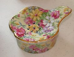 floral chintz pattern tea strainer/teabag holder and drip cup, with gilded edges, ceramic