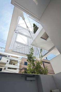 Hiroyuki Moriyama completes Tokyo apartment building with a perforated skin Japan Architecture, Architecture Design, Perforated Metal Panel, Tokyo Apartment, Sea Container Homes, Basement Apartment, Social Housing, Japanese House, Luxury Apartments