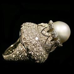 Art Deco Platinum Pearl Diamond Ring weighing approximately 6.50 carats of Diamonds, accompanied with a 12 1/2 mm South Sea Pearl