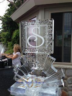 Monogram S martini luge on Sunburst pedestal ice sculpture