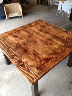 Table that was torched to bring out the grain. Bottom was stained and the whole thing was sealed with polyurethane. #table #wood #torched #stained #custom