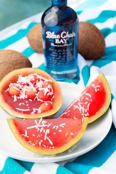 Summer is here so it's time for watermelon Jell-O shots. This easy rum shots recipe is perfect for the summertime! Enjoy it during Memorial Day, Labor Day, or even the 4th of July It only requires a few ingredients which means its easy to make at home. Click here for the recipe. #bluechairbay #coconutrum #rumcocktail