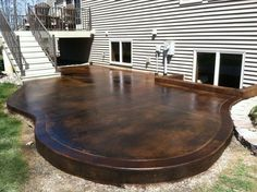 Exterior, Awesome Exterior Stained Concrete Patio For Your Lovely Backyards: Inspiring Design Of The Patio With Glossy Black And Brown Ceram...